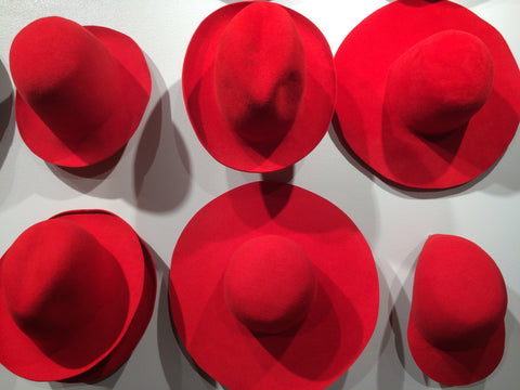 Red colour wool felt hats in éN Hats shop Kämp Garden Helsinki