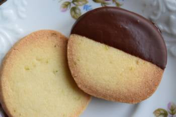 Lime cookie dipped in dark chocolate