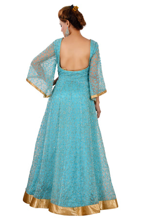 Light Blue and Golden Evening Style Gown Featured in Tissue