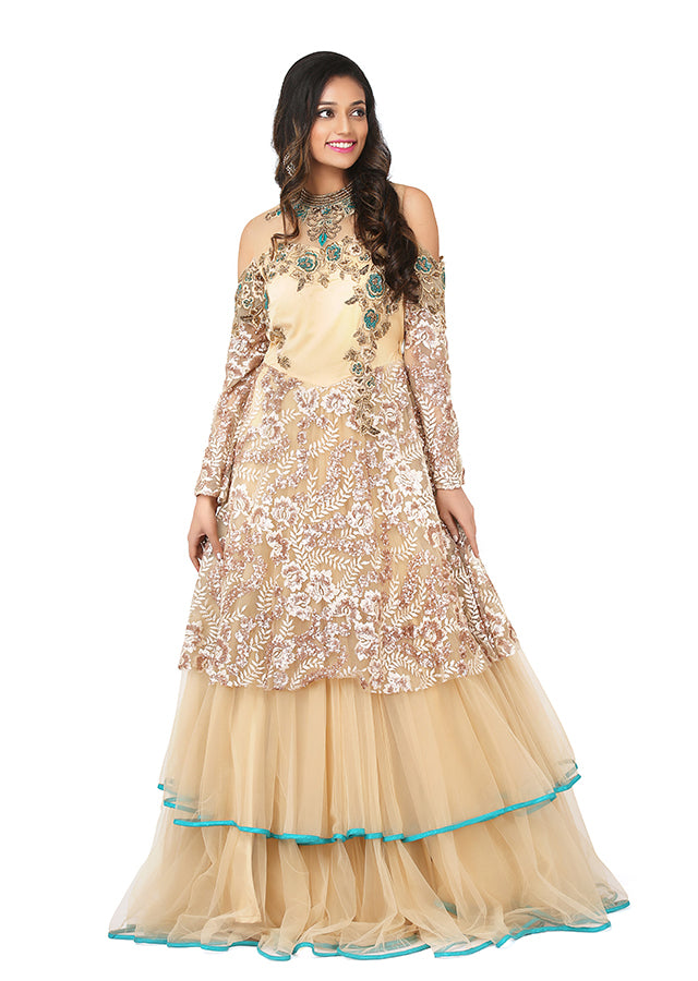 Peach and green indo-western style gown featured in Brocade and net