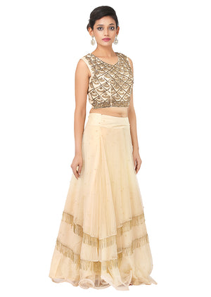 Peach and Golden Lehenga featured with heavy stone and zari work