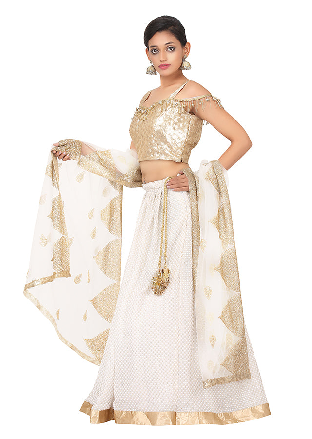 White and gold lehenga featured in georgette and net