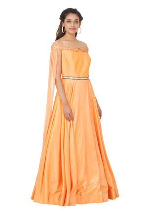 Peach evening style gown featured in raw silk and chiffon