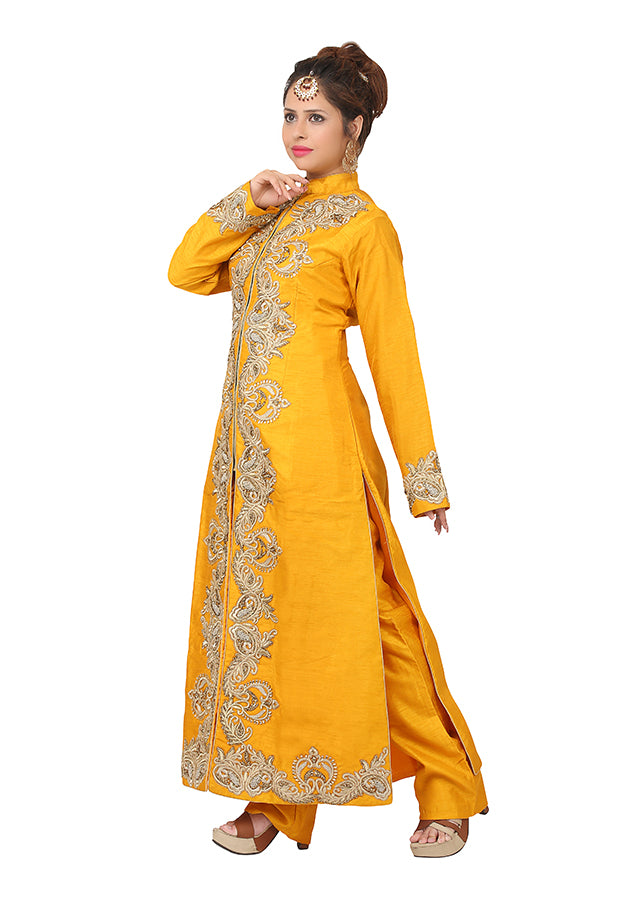 Mustard palazzo suit featured in raw silk and net dupatta