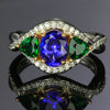 white and rose gold tanzanite and tsavorite ring