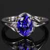 14K white gold oval tanzanite ring with 2 side diamonds