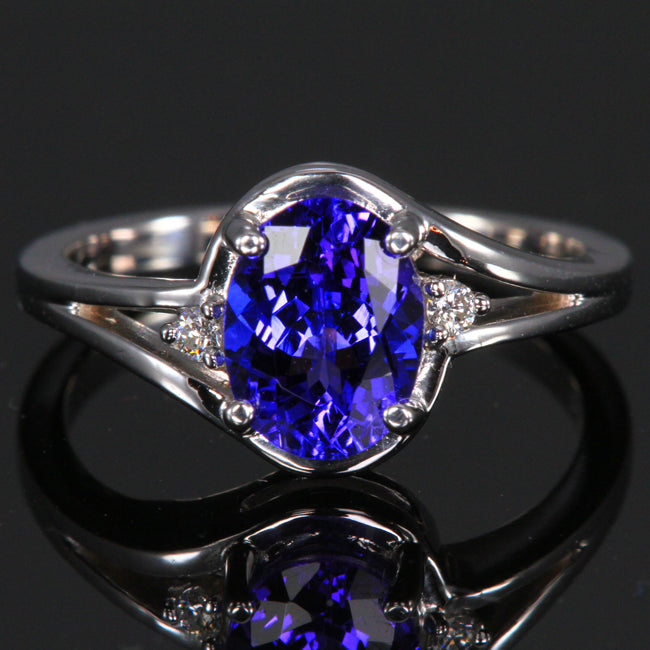 7848391593550 14K white gold oval tanzanite ring with 2 side diamonds