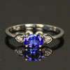 14K White Gold .52 Carat Tanzanite with Two Diamond Ring