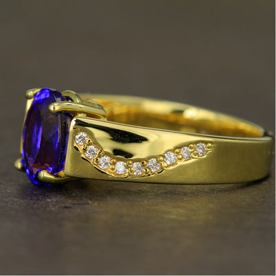 Tanzanite Ring 3.26 Carats 14 Karat Yellow Gold