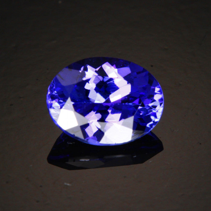 split shank oval diamond tanzanite and top ring
