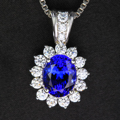 14k White Gold Tanzanite and Diamond Halo Pendant 6.17 Carats designed by Christopher Michael