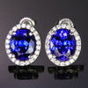 14K White Gold Oval Tanzanite and Diamond Halo 4.21 Carats