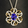 two tones yellow and white gold unique tanzanite and diamond pendat