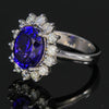custom designed 18K White gold oval tanzanite and diamond halo ring
