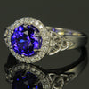 Tanzanite Ring with Halo of Diamonds and Celtic Design