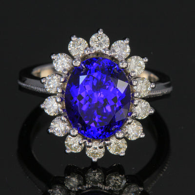 18k White Gold Tanzanite Ring with Halo of Diamonds 4.72 Carats