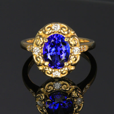 18k Yellow gold oval tanzanite and diamond ring