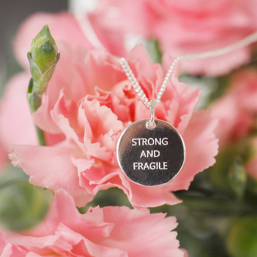 Strong and Fragile pendant