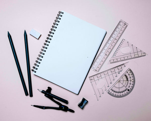 Notebook with pencils, rulers, compass