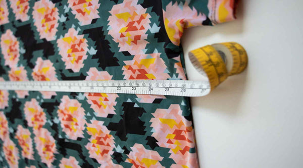 Measure 2.5cm below the armhole to find a garments chest measurement
