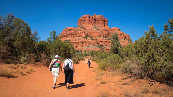 Hiking towards the Bell red rock formation in Sedona