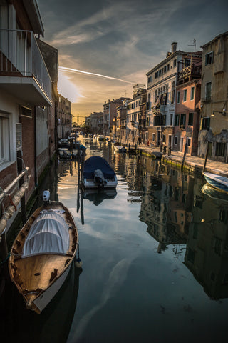 Sunset reflected on the Rio de la Sensa in Venice Italy