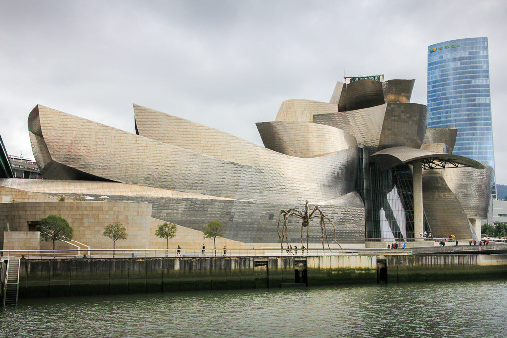 Looking across the river towards the silvery Guggenheim art gallery in Bilbao, part of the travel that inspired the creation of Asmuss clothing
