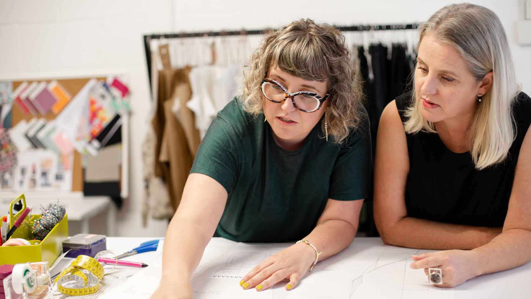 Asmuss Founder Clare and Fiona discussing a pattern in their studio