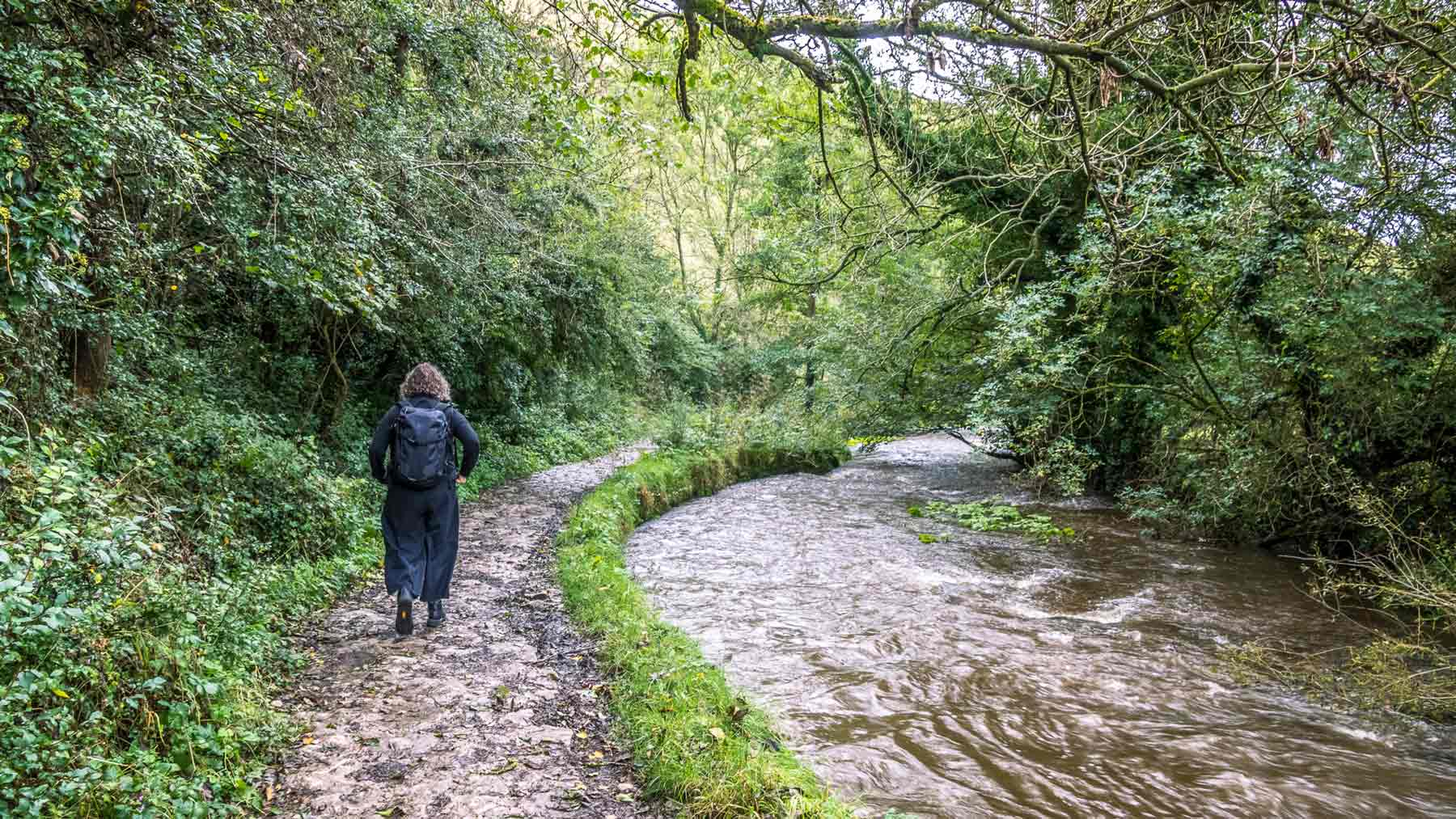 Clare, wearing Asmuss, walking alongside the River Dove