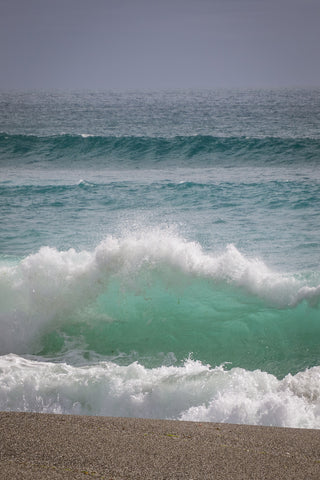 Wave breaking with clear sea green water