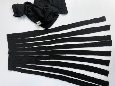 The body of the t-shirt cut into strips that has been separated from the section above the armholes