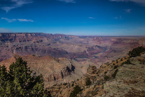 Bright blue sky over the Grand Canyon with the Colorado River visible below