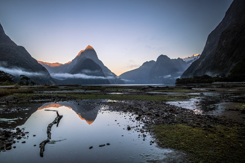 Sunrise at Milford Sound with Mitre Peak and still reflective water