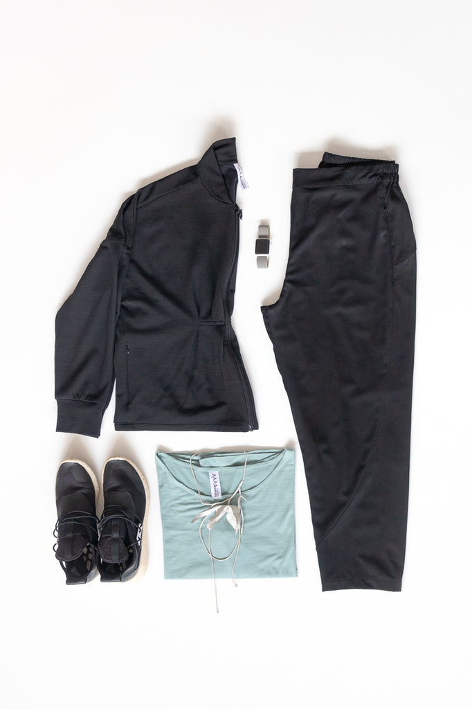 Flat lay image of Asmuss clothing to pack for travel to Fogo Island