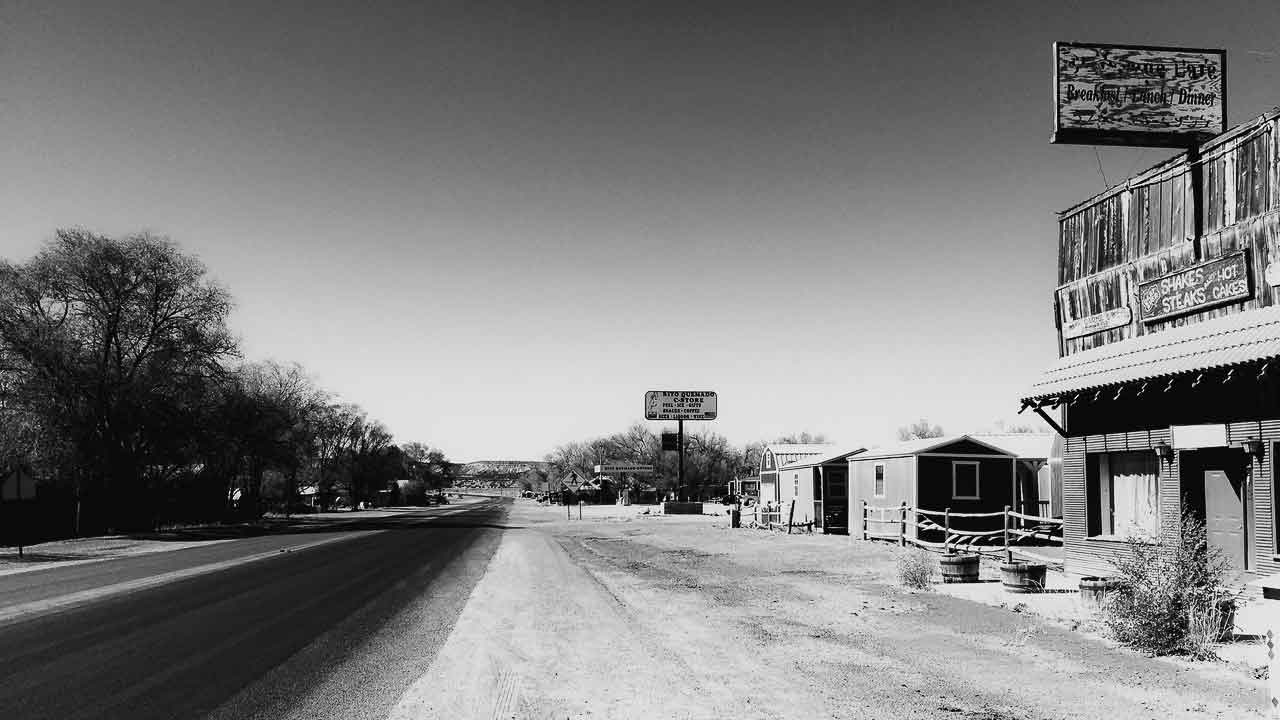 Black and white view down the empty road outside the Dia Art Foundation office in Quemado New Mexico
