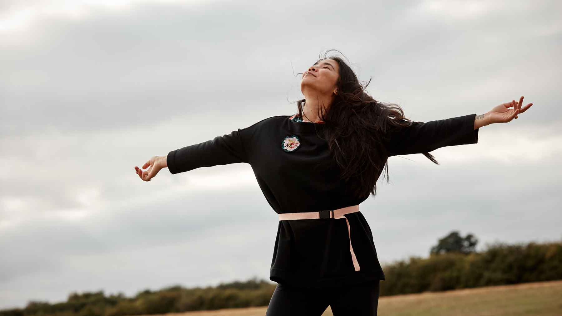Woman with arms wide open wearing the Asmuss Oversize Boat Neck Sweat made from our Wool Fleece fabric