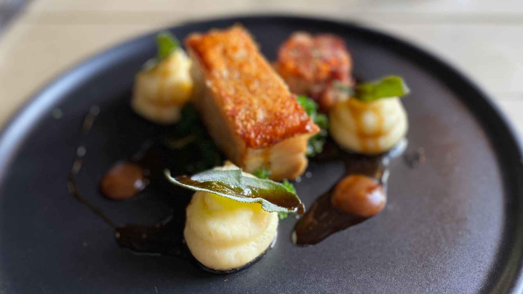 Beautifully prepared and presented pork belly dish at The George Alstonefield, Peak District