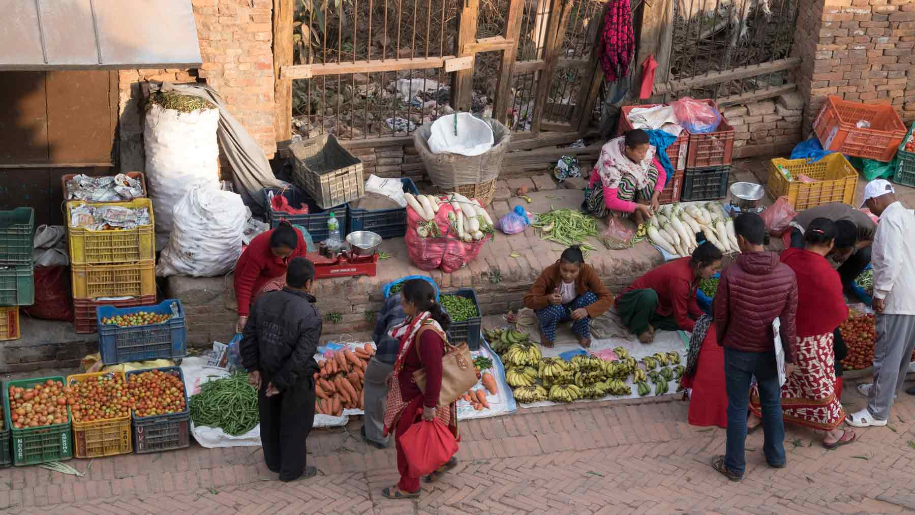 Group discussing the vegetables for sale in the square in Bhaktapur Nepal