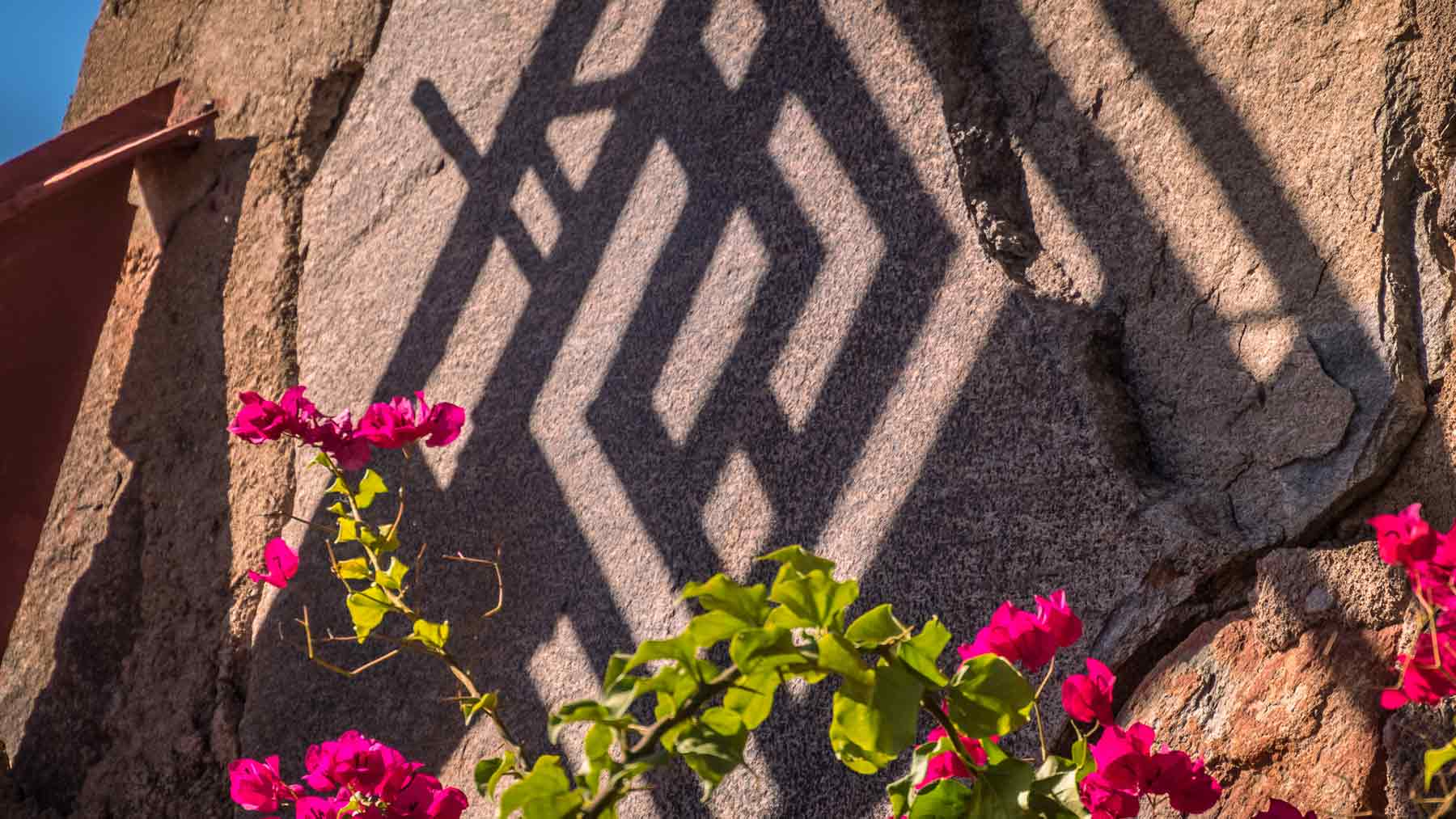 Shadow of the Taliesin West symbol on a wall