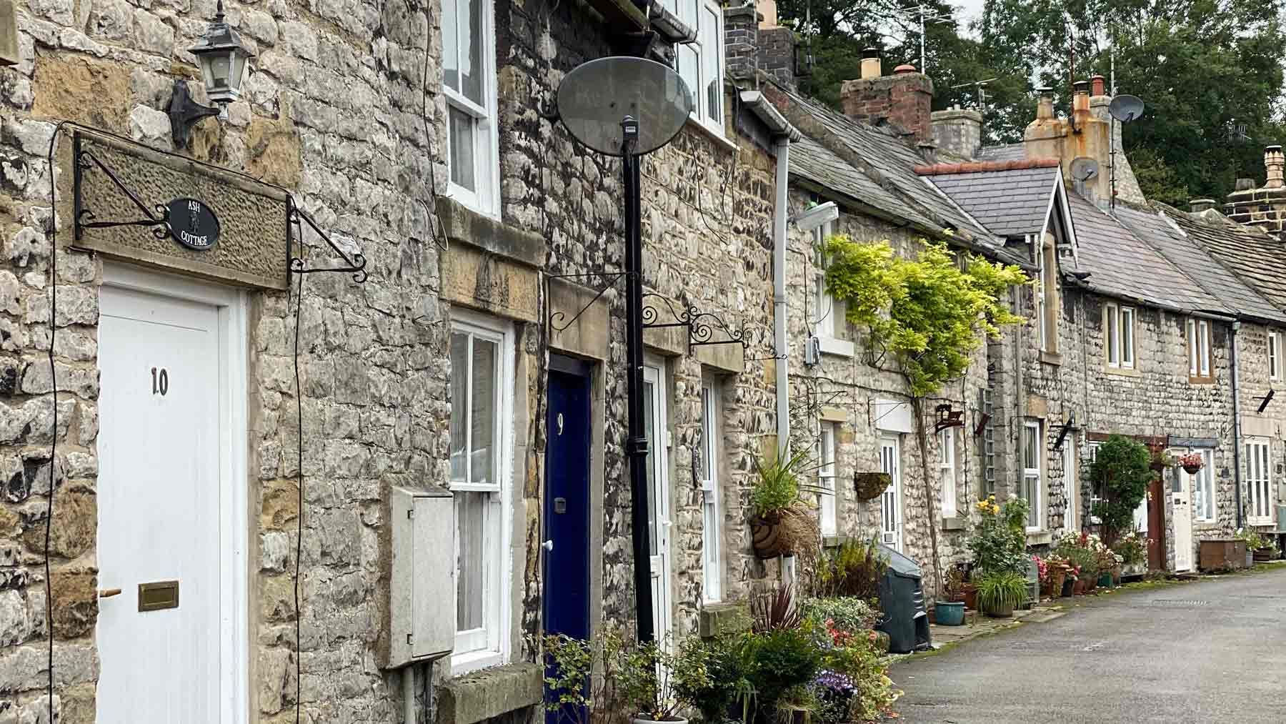Pretty grey stone cottages in Tidewell, Peak District