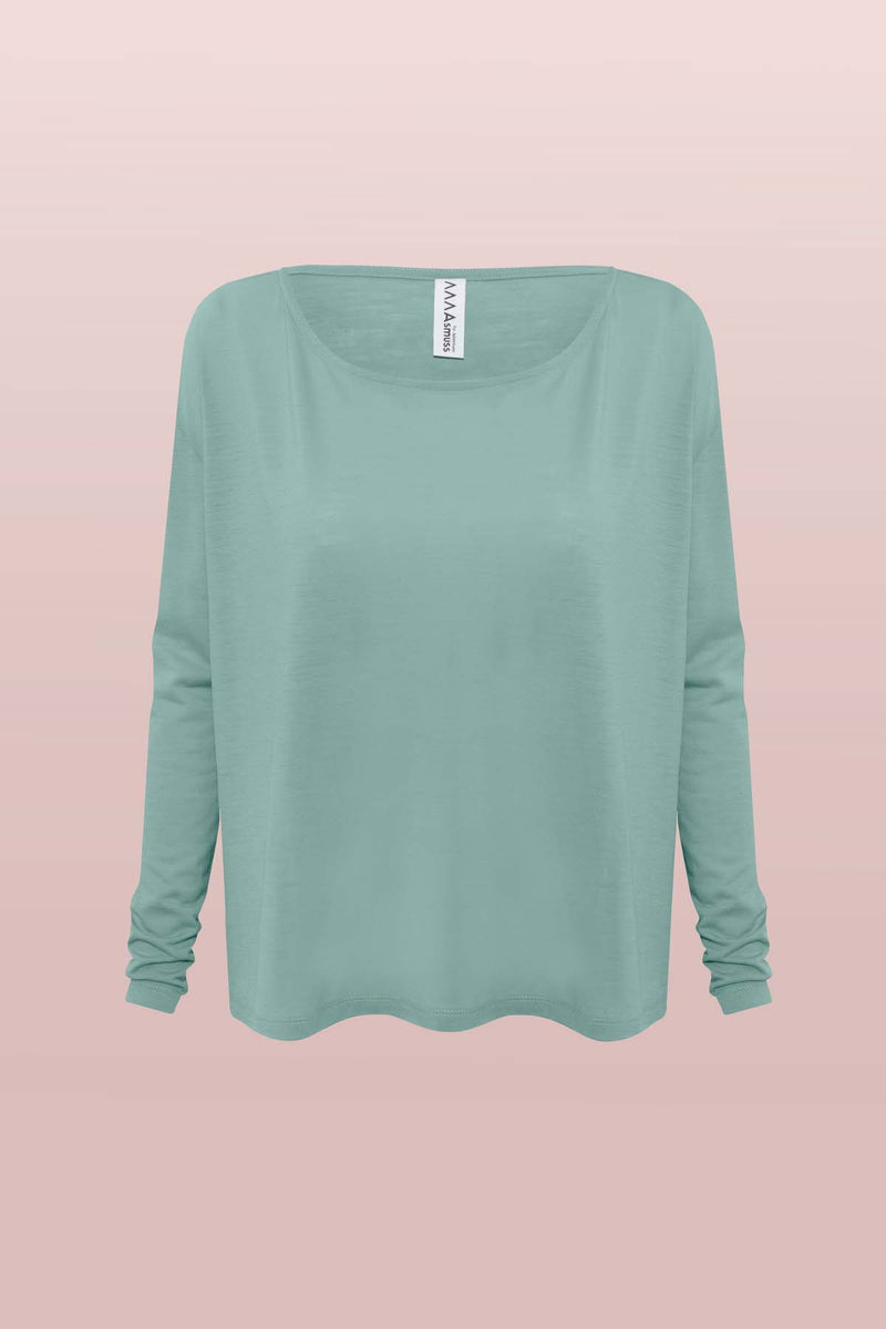 Front view of the Asmuss Long Sleeve A-line T-shirt in Sea Green. A great elevate essential for everyday or travel adventures made from soft wool blended with 37.5 Technology to help regulate your body temperature