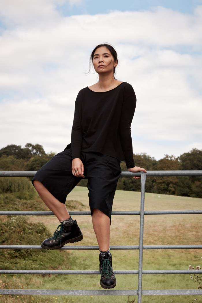 Woman wearing Asmuss A-line Long Sleeve T-shirt in Black. A perfect elevated essential with built in temperature regulating technology