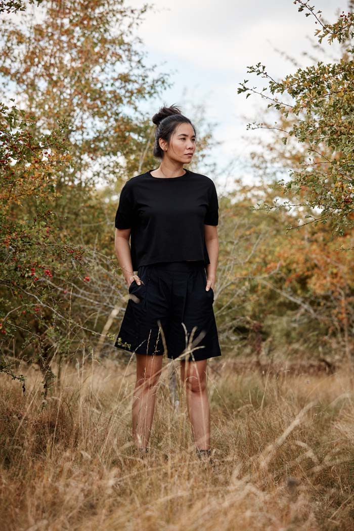 Woman wearing the Asmuss Boxy Cropped T-shirt in Black. Your ideal elevated essential t-shirt with innovative temperature regulating 37.5 Technology helps keep you feeling dry and comfortable. You'll be ready for all your everyday adventures.