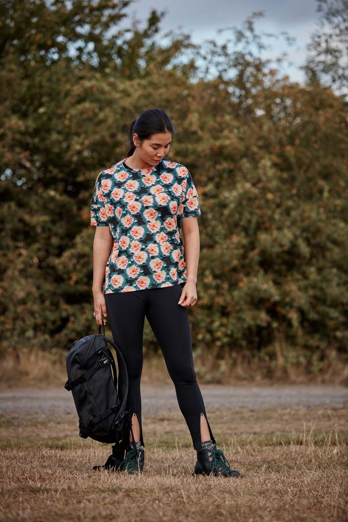 Woman out for a countryside walk wearing the Asmuss Geometric Rose Print T-shirt a great activewear or casual wear t-shirt. Stylish and sustainable, made from 100% recycled materials, lifestyle womenswear for your everyday adventures.