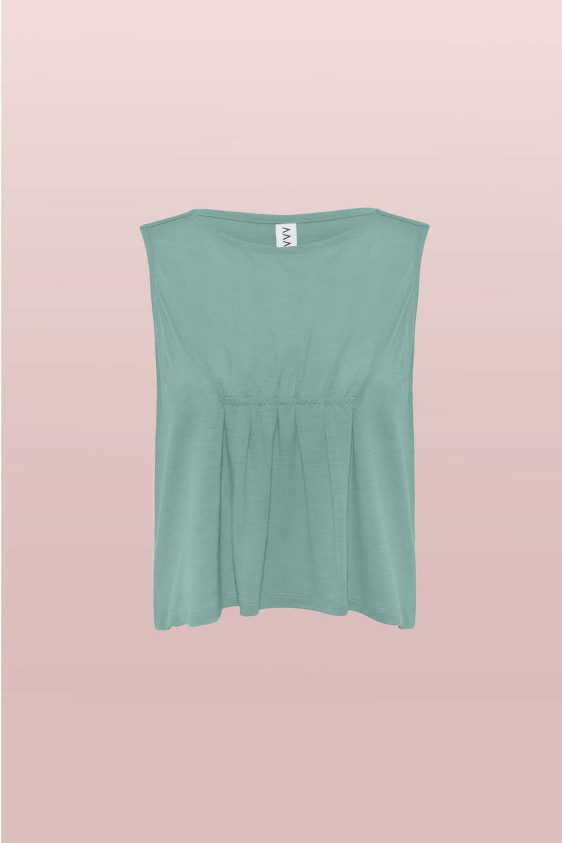 Front view of the Asmuss Pleated Tank in sea green. Made in the UK from a blend of wool and 37.5 technology to help keep your ideal body temperature so it is perfect for travelling with or wearing at home or office. A great elevated essential for all your everyday adventures.