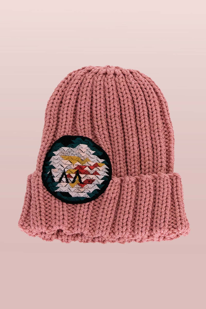 Asmuss Limited Edition Hand Knitted Beanie in Pink with Geometric Rose Embroidered Badge to elevate your winter essential. It is made from yarn that would have gone to waste so it is it truely sustainable.
