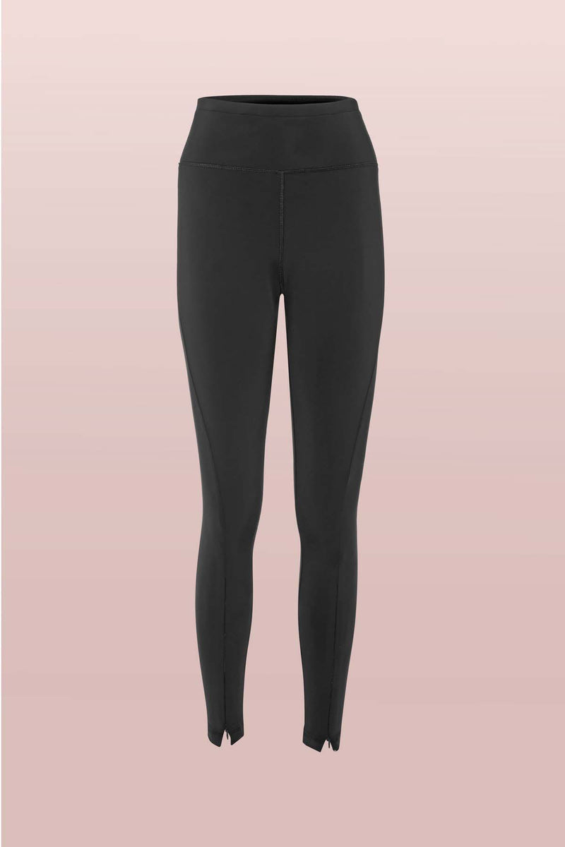 Front view of the Asmuss Twisted Leggings with zip detail on lower front leg, pocket in front waistband and drawstring to keep them snug. Made in the UK from recycled nylon and elastane for 4 way stretch. Sustainable activewear that looks great on for all your everyday adventures including lazing on the couch or out running.