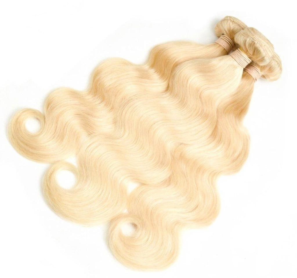 Brazilian Blonde Body Wave Virgin Human Hair Extensions Sold by Soie Virgin Hair Extensions In Atlanta, Georgia. We deliver or ship everywhere. Call 404-669-6832 or visit https://SoieHair.com