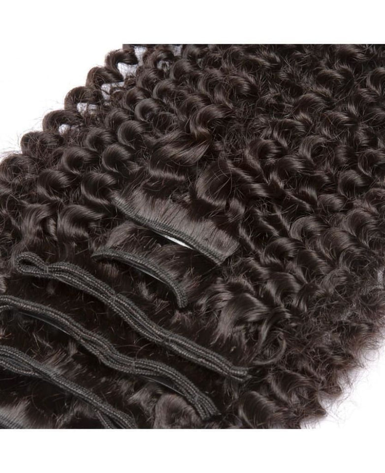 Natural Kinky Curly Clip-In Human Hair Extensions by Soie Virgin Hair Extensions In Atlanta, Georgia. We deliver or ship everywhere. Call 404-669-6832 or visit https://SoieHair.com
