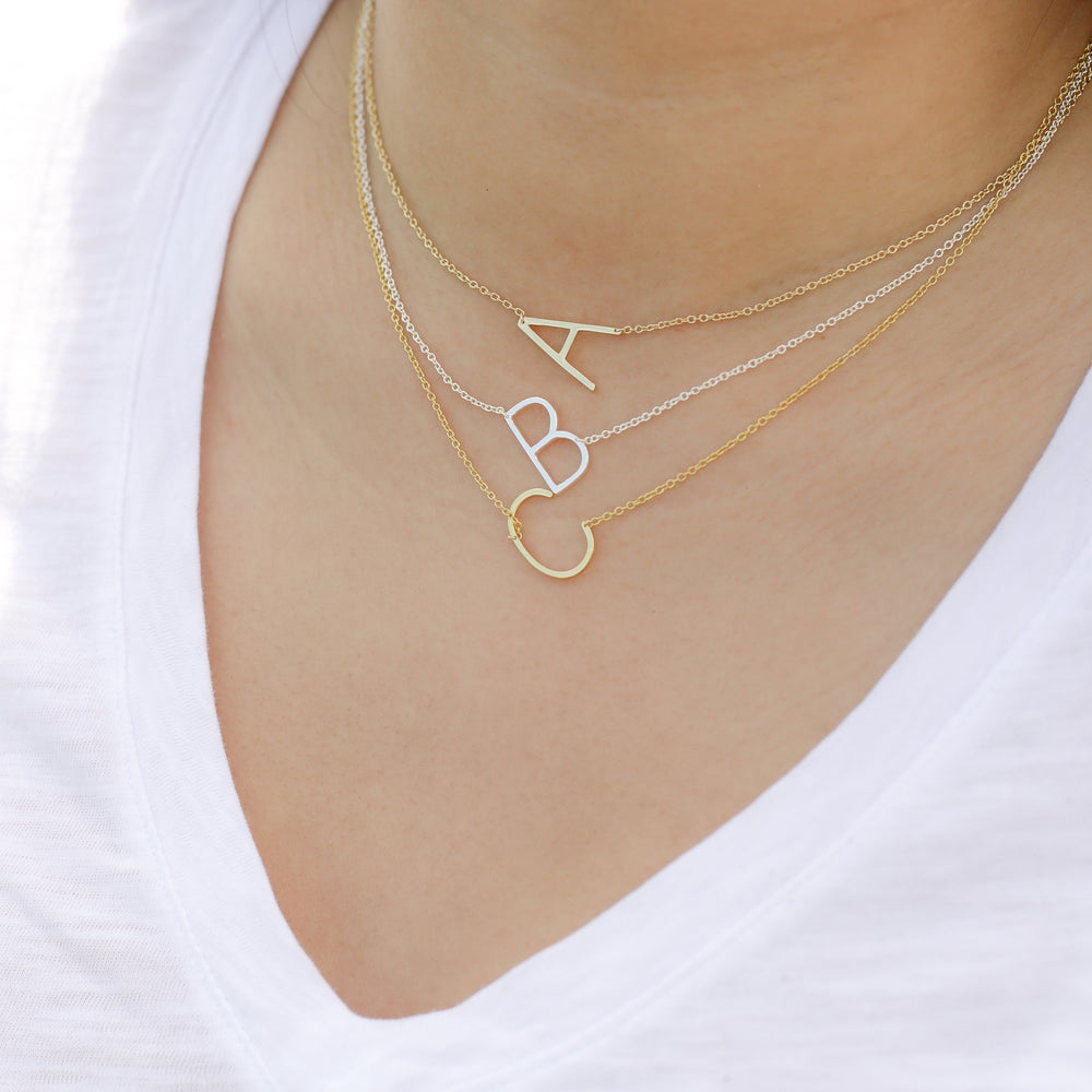 sideways capitial letter initial necklaces in gold and silver